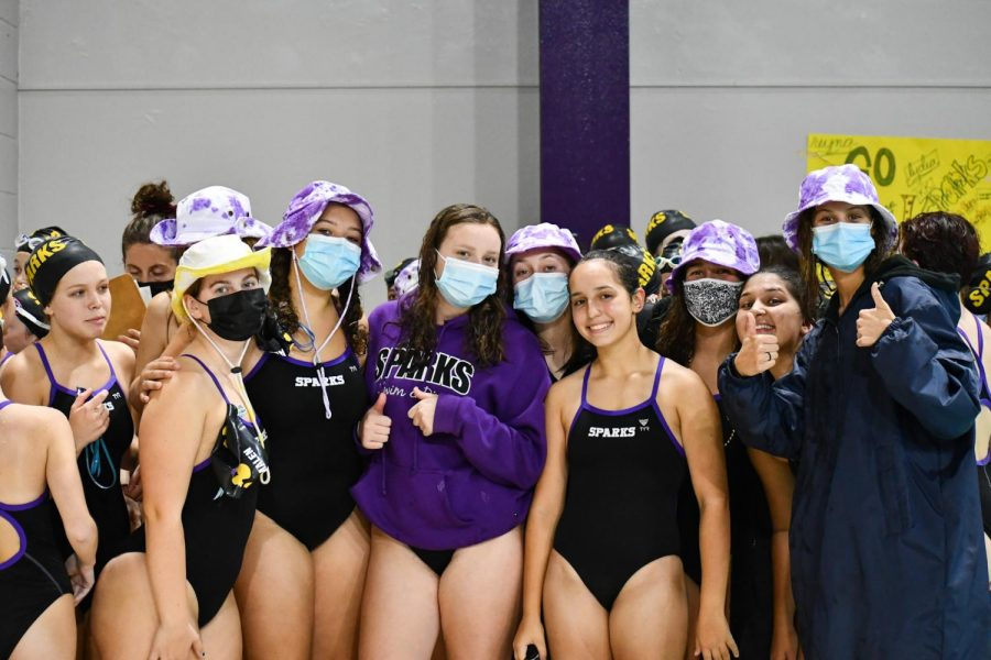 Before the meet starts, the Sparks get together to do their cheer. The SPARKS are a co-op swim and dive team with Highland Park.