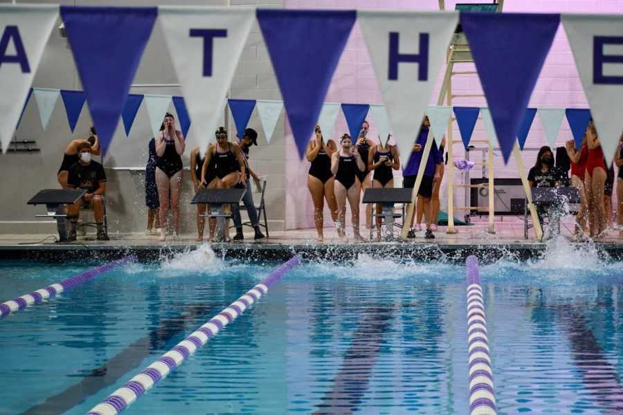 The relay begins. The backstrokers dive into the water and begin not only the first leg of the race but also swim the first lap of the meet.