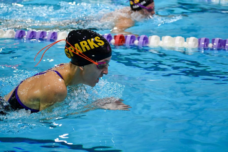 Senior Ellie Sandeen has a little over 50 yards left of her 200 IM left as she swims breaststroke to the wall.