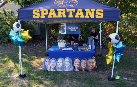 The stand shows off the snacks and posters the seniors received after the game.