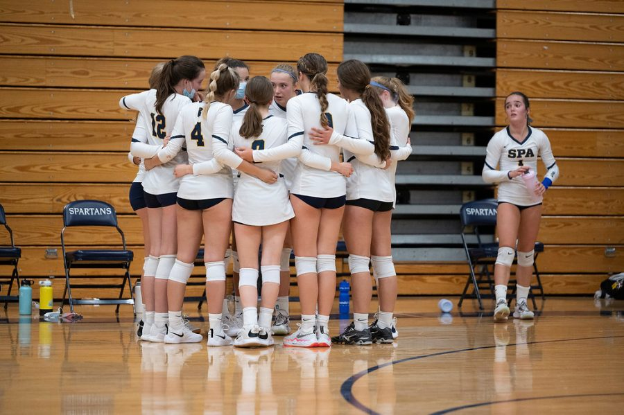 """TOGETHER, WE SUCCEED. Captain Solvej Eversol encourages the team as they face a tough game ahead. """"Spartans on 3; 1,2, 3 Spartans"""" they chant as the time sounds, and the set continues. The team, after encouragement and water, will go on to the court with a new mindset."""